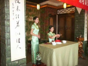 A Young Girl Conducting A Tea Ceremony